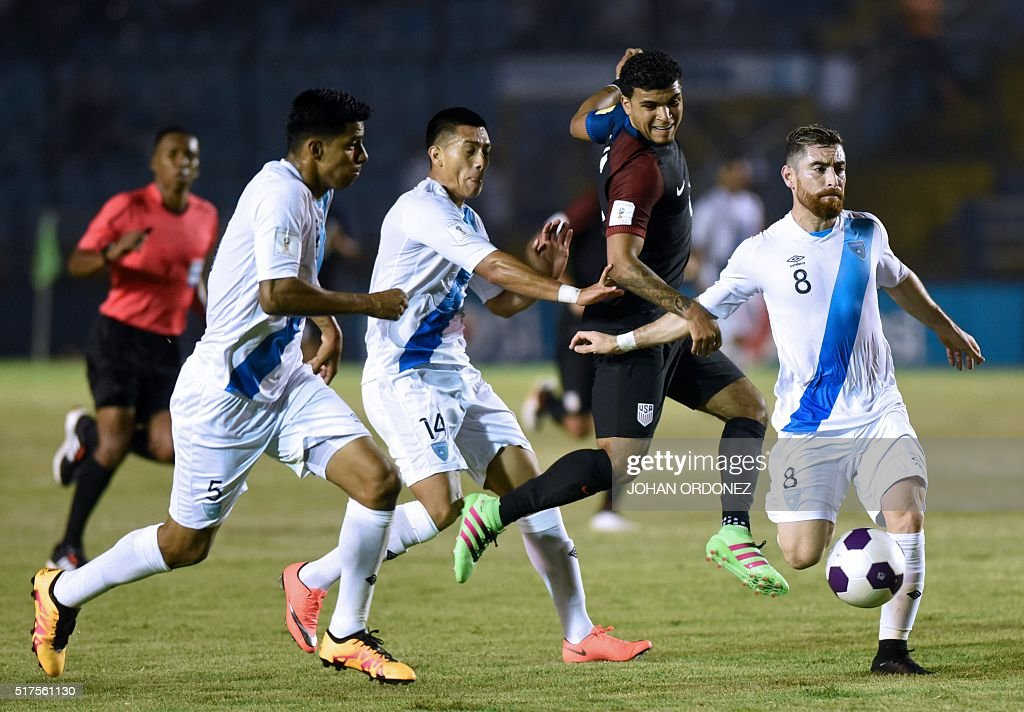USA's De Andre Yedlin (2-R) kicks the ball as Guatemala's Moises Hernandez (L), Rafael Morales (2-L) and Jean Marquez mark him during their Russia 2018 FIFA World Cup Concacaf Qualifiers' football match, in Guatemala City, on March 25, 2016.