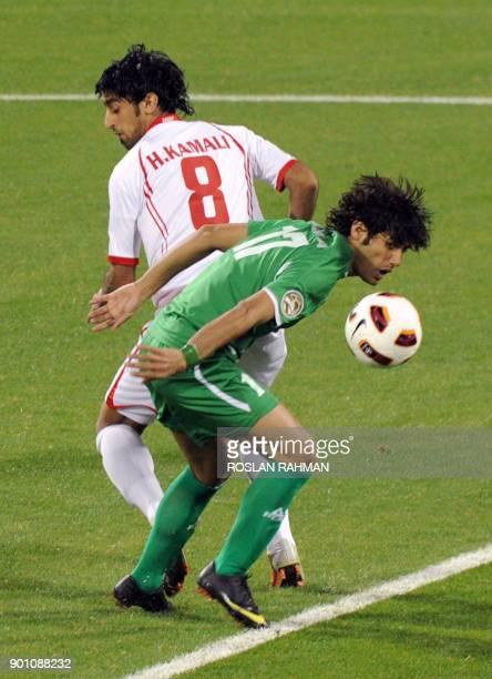 UAE's defender Hamdan alKamali challenges Iraq's forward Alaa Abdulzahra during their 2011 Asian Cup group D football match at the AlRayyan Stadium...