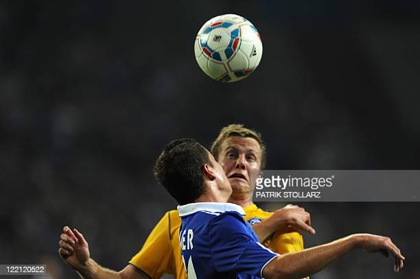 HJK's defender Mathias Lindstroem and Schalke's defender Julian Draxler during the UEFA Europa League playoff football match Schalke 04 vs HJK...