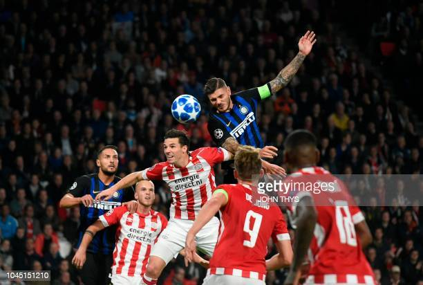 TOPSHOT PSV's defender Nick Viergever vies for the ball with Inter Milan's forward Mauro Icardi during the UEFA Champions League group stage football...