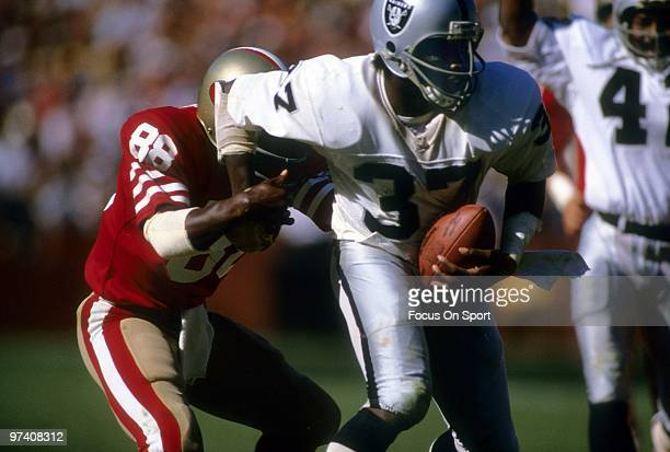 SAN FRANCISCO CA CIRCA 1980's Defensive back Lester Hayes of the Oakland Raiders in action running back an interception tries to break away from wide...
