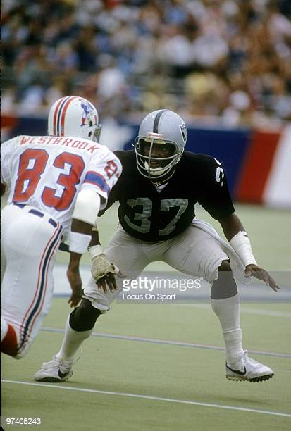 FOXBOROUGH MA CIRCA 1980's Defensive back Lester Hayes of the Oakland Raiders in action guarding wide receiver Don Westbrook of the New England...