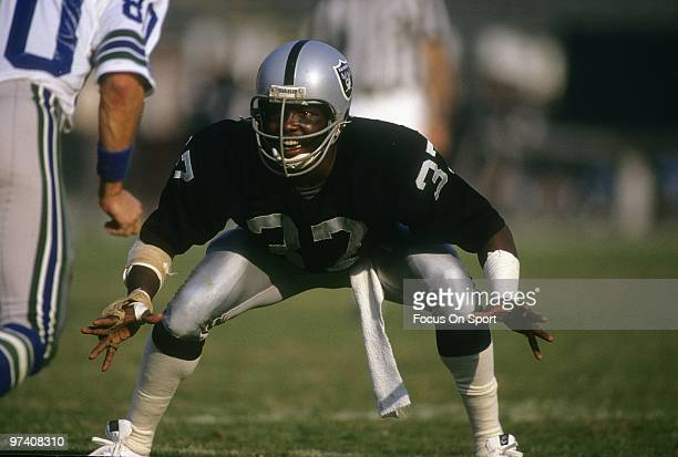 OAKLAND CA CIRCA 1980's Defensive back Lester Hayes of the Oakland Raiders in action guarding wide receiver Steve Largent of the Seattle Seahawks...
