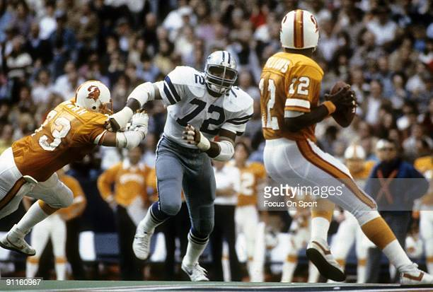 DALLAS TX CIRCA 1980's Defensive end Ed Jones of the Dallas Cowboys gets past guard Charley Hannah of the Tampa Bay Buccaneers to rush quarterback...