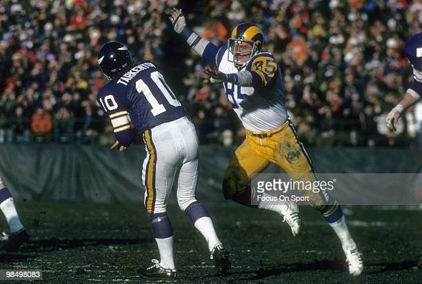 MINNEAPOLIS MN CIRCA 1970's Defensive End Jack Youngblood of the Los Angeles Rams attempts to block the pass of quarterback Fran Tarkenton of the...