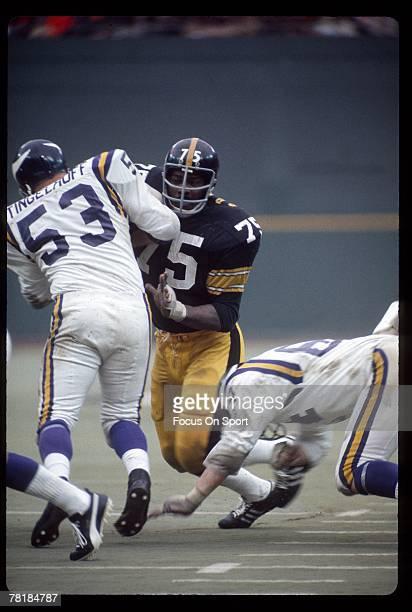 PITTSBURGH PA CIRCA 1970's Defensive lineman Joe Green of the Pittsburgh Steelers is blocked by Minnesota Vikings offensive lineman Mick Tingelhoff...