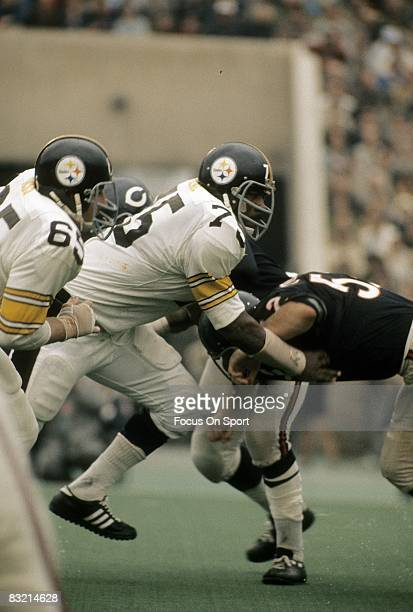 CHICAGO IL CIRCA 1970's Defensive lineman Joe Greene of the Pittsburgh Steelers rushes the Chicago Bears line during a mid circa 1970's NFL football...