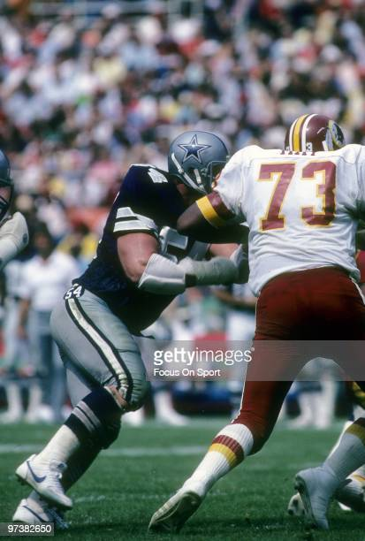 C CIRCA 1980's Defensive Tackle Randy White of the Dallas Cowboys in action against offensive tackle Mark May of the Washington Redskins circa 1980's...