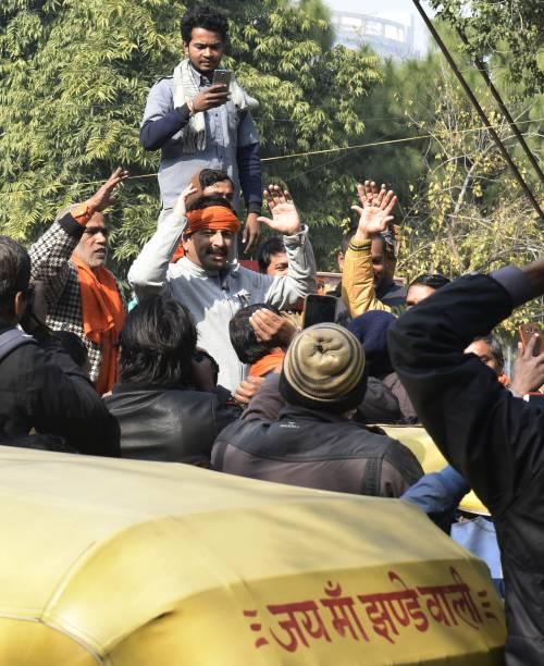 IND: BJPs Delhi Unit President Manoj Tiwari Addresses Auto-Rickshaw Drivers Outside BJP Office