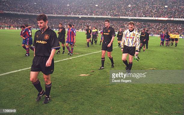 UNITED's DENNIS IRWIN LEADS HIS TEAM OFF THE PITCH DEJECTED AFTER LOSING 40 TO BARCELONA IN THE CHAMPIONS LEAGUE MATCH AT THE NOU CAMP STADIUM IN...