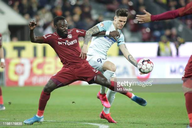 FCSB's Dennis Man fights for the ball with CFR Cluj's Kevin Boli during the Liga I match between CFR Cluj and FCSB at DrConstantinRadulescuStadium on...