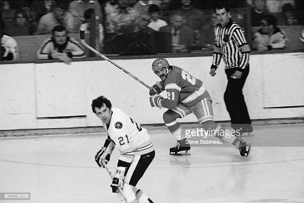 BOSTON MA 1970's Dennis Maruk of the California Golden Seals skates in game against Don Marcotte the Boston Bruins at Boston Garden