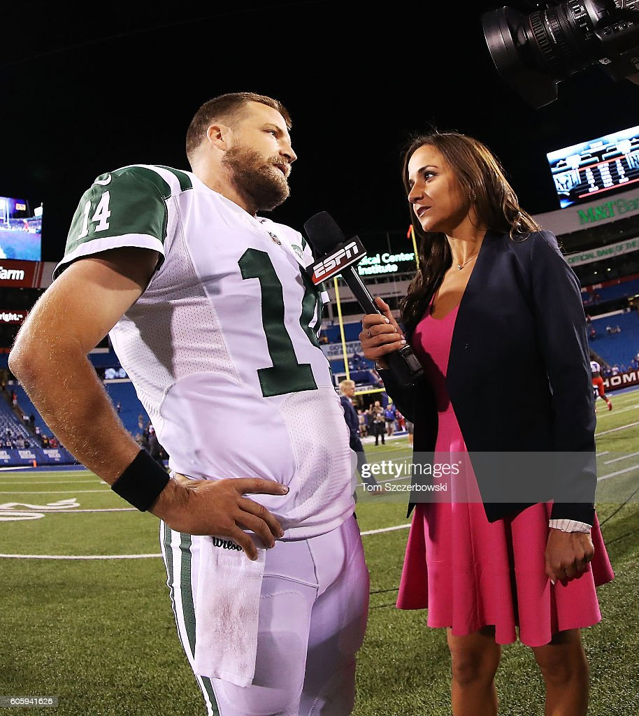 ESPN's Dianna Russini interviews Ryan Fitzpatrick #14 of the New York Jets after the New York Jets beat the Buffalo Bills 37-31 at New Era Field on September 15, 2016 in Orchard Park, New York.
