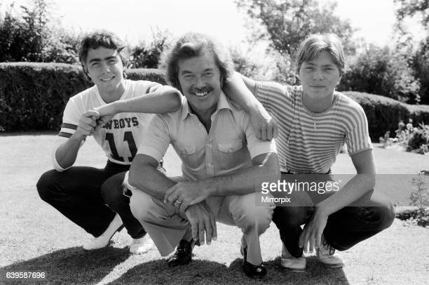 S Dickie Davies with his two sons, Pete and Dan, pictured at their Hampshire home. 10th September 1980.