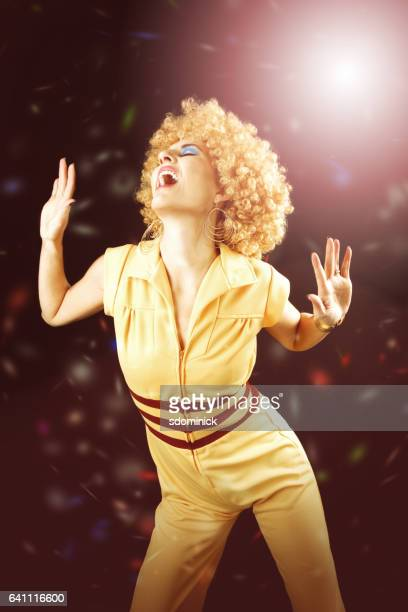 70's disco dancing - permed hair stock photos and pictures