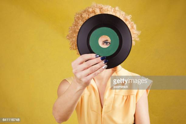 70's disco woman looking through 45 record - permed hair stock pictures, royalty-free photos & images