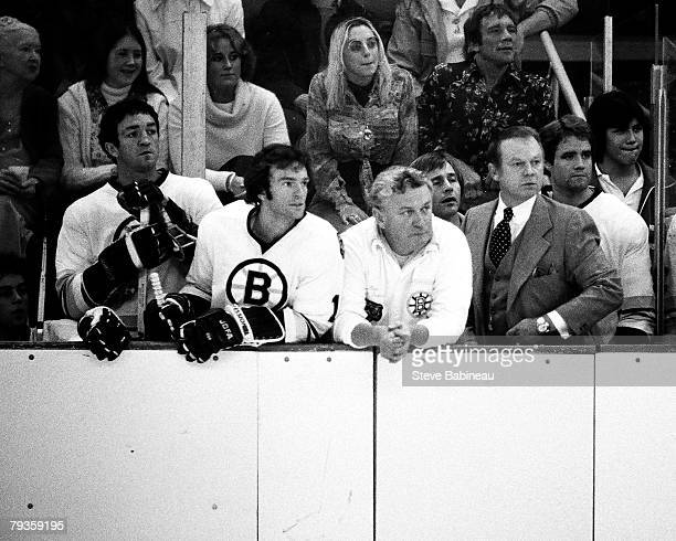 BOSTON MA 1970's Don Cherry coach of the Boston Bruins along with players view action at Boston Garden