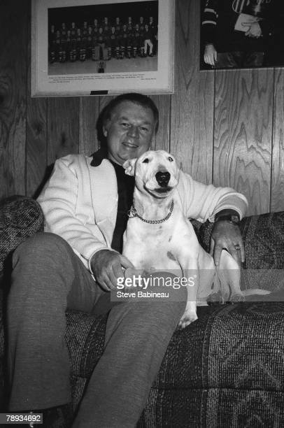 BOSTON MA 1970's Don Cherry head coach of the Boston Bruins poses with his dog