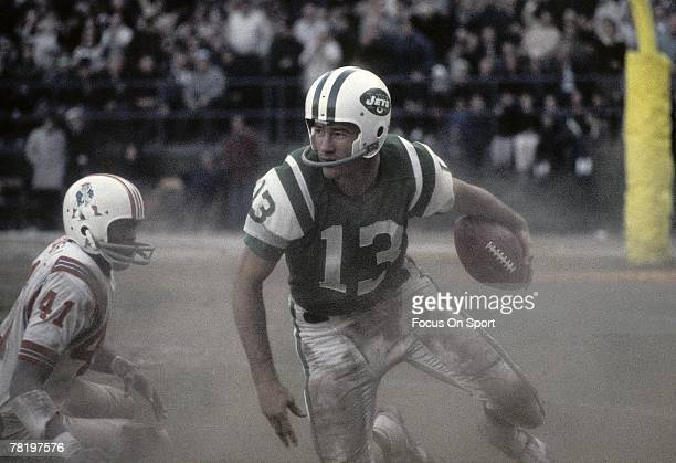 NEW YORK NY CIRCA 1960's Don Maynard of the New York Jets gets away from a Boston Patriots defenders in a mid 1960's circa NFL football game at Shea...