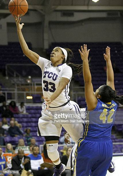 TCU's Donielle Breaux makes a lay up against Southern Arkansas' Aarika Reyna during a women's college basketball game at Daniel Meyer Coliseum in...
