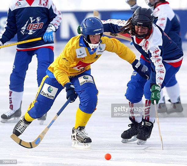 USA's Donna Forbes tries to stop Sweden's Anna Lundin during the women Bandy World championships 19 February 2004 in Lappeenranta Finland Bandy is...