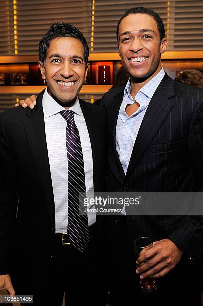 CNN's Dr Sanjay Gupta and T J Holmes attend CNN's Dr Sanjay Gupta Cheating Death Book Party at Rogue Tomate on December 14 2009 in New York City...