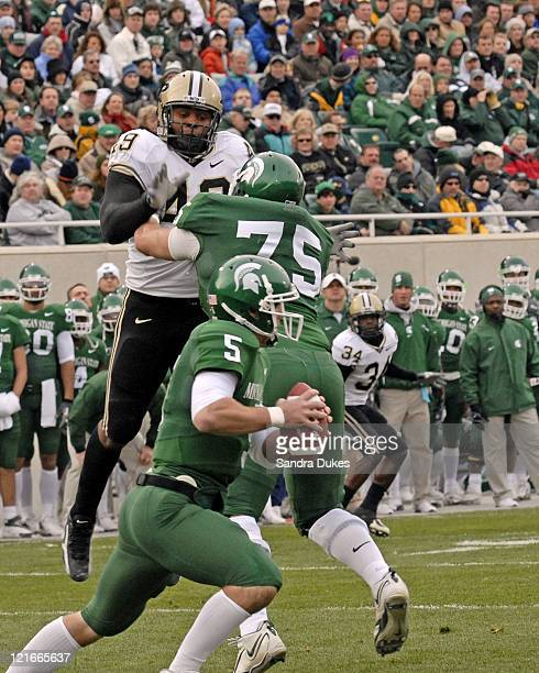 S Drew Stanton tucks the ball and runs as Purdue's Anthony Spencer closes in during the 2nd quarter in the Purdue win over Michigan State, 17-15 at...