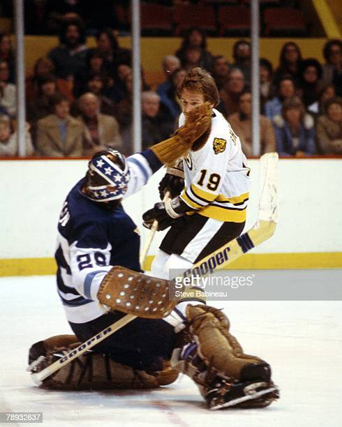 BOSTON MA 1970's Dunc Wilson of the Pittsburgh Penguins makes save against Greg Sheppard of the Boston Bruins