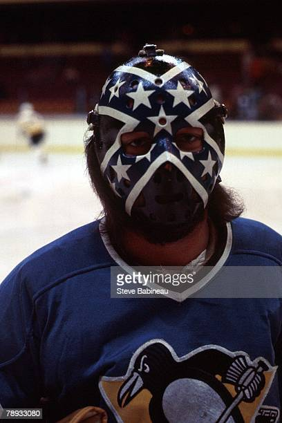 BOSTON MA 1970's Dunc Wilson of the Pittsburgh Penguins poses for picture against the Boston Bruins