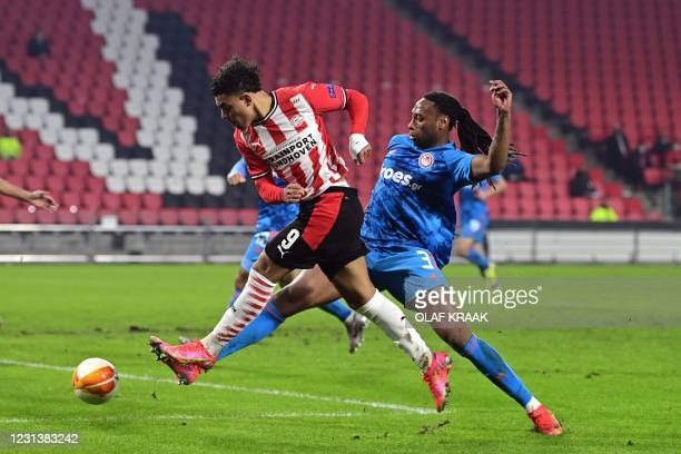 S Dutch forward Donyell Malen is challenged by Olympiakos's Portuguese defender Ruben Semedo during the UEFA Europa League round of 32 second-leg...