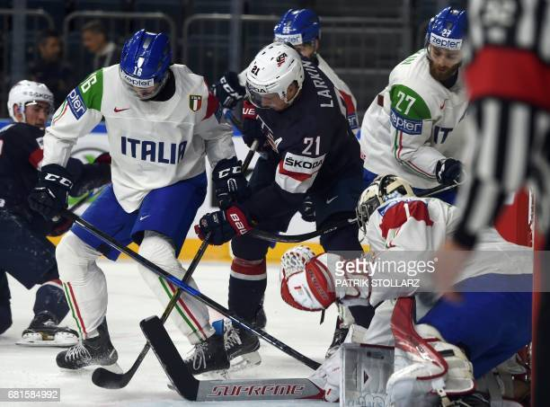 S Dylan Larkin and Italy´s Giovanni Morini vie during the IIHF Ice Hockey World Championships first round match between USA and Italy in Cologne,...