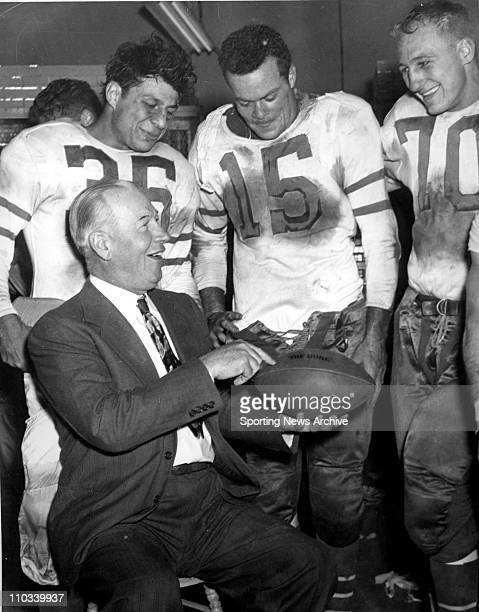 1940's Ed'' Greasy'' Neale of the Philadelphia Eagles with ball following teams 1st championship 70 victory over Chicago Cardinals in snow at shibe...
