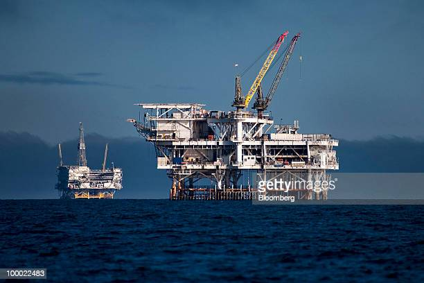 LLC's Edith offshore oil and gas platform right and Beta Operating Company LLC's Eureka oil and gas platform stand in the Beta Field off the coast of...
