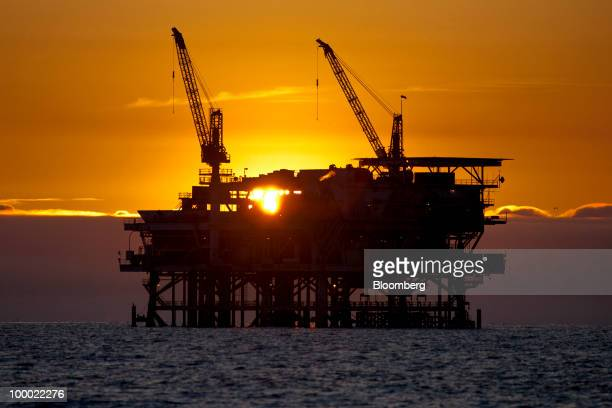 LLC's Edith offshore oil and gas platform stands at sunset in the Beta Field off the coast of Long Beach California US on Tuesday May 18 2010...