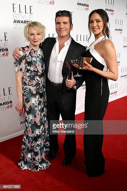 UK's EditorinChief Lorraine Candy and Lauren Silverman pose with Simon Cowell winner of the Outstanding Contribution to Entertainment Award in the...