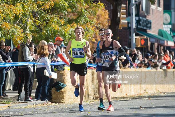 USA's eighth place finisher Tyler Pennel and Jon Grey of USA compete at the 2016 TCS New York City Marathon in Queens on November 6 2016 in New York...