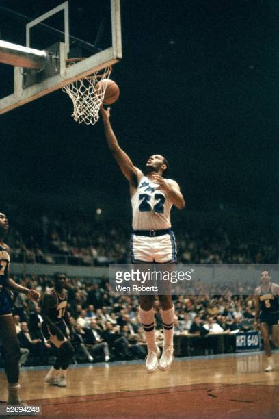 LOS ANGELES 1970's Elgin Baylor of the Los Angeles Lakers goes for a layup against the Golden State Warriors during the NBA game at the Los Angeles...