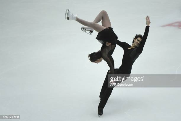 TOPSHOT US's Elliana Pogrebinsky and Alex Benoit perform during the Ice Dance Free Dance at the Cup of China ISU Grand Prix of Figure Skating in...