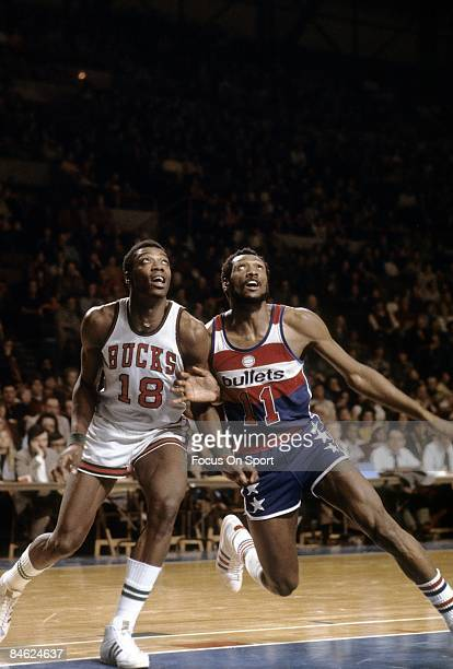 S: Elvin Hayes of the Washington Bullets fights for position under the basket with Curtis Perry of the Milwaukee Bucks during a mid circa 1970's NBA...