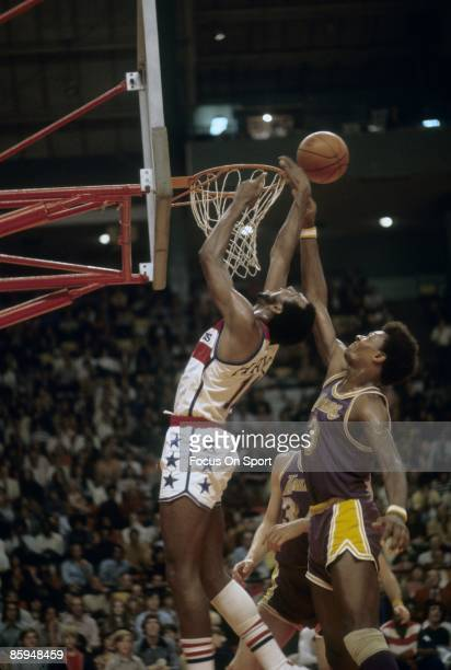 BALTIMORE MD CIRCA 1970's Elvin Hayes of the Washington Bullets shoot over Elmore Smith of the Los Angeles Lakers during a mid circa 1970 NBA...