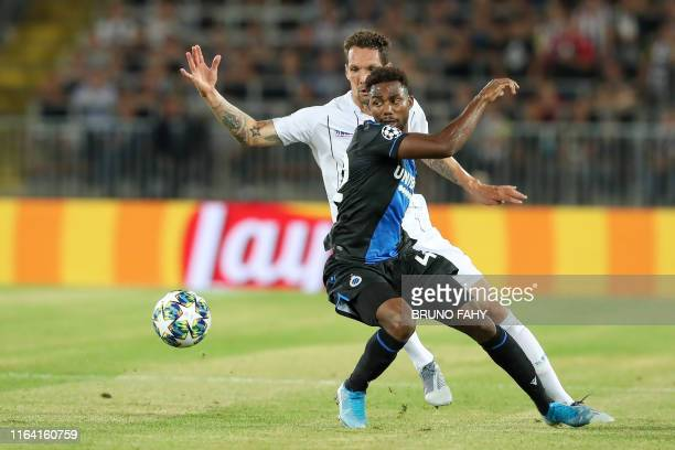 LASK's Emanuel Pogatetz and Club's Emmanuel Bonaventure Dennis fight for the ball during the match of Belgian soccer team Club Brugge KV against...