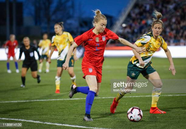 USA's Emily Sonnett tries to get a shot off in front of Australia's Elise KellondKnight during their International Friendly at Dick's Sporting Goods...