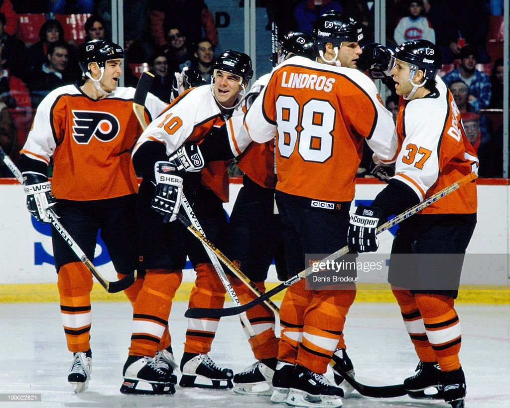 MONTREAL - 1990's: Eric Lindros #88 of the Philadelphia Flyers celebrates a goal with his teammates during the game against the Montreal Canadiens in the early 1990's at the Montreal Forum in Montreal, Quebec, Canada.