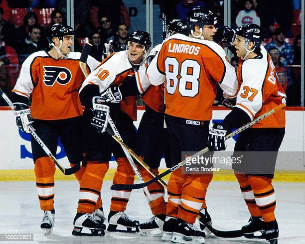 MONTREAL 1990's Eric Lindros of the Philadelphia Flyers celebrates a goal with his teammates during the game against the Montreal Canadiens in the...