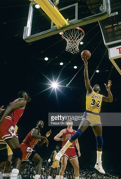 LOS ANGELES CA CIRCA 1980's Ervin Magic Johnson of the Los Angeles Lakers goes in for a layup against the Chicago Bulls during a circa 1980's NBA...