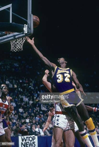 BALTIMORE MD CIRCA 1980's Ervin Magic Johnson of the Los Angeles Lakers lays the ball up against the Capital Bullets during a circa 1980's NBA...