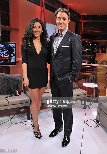 CTV's eTalk hosts Tanya Kim and Ben Mulroney pose in the eTalk Lounge during the 2011 Juno Awards at the Air Canada Centre on March 27 2011 in...