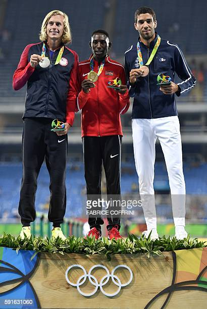USA's Evan Jager Kenya's Conseslus Kipruto and France's Mahiedine Mekhissi pose during the podium ceremony for the men's 3000m steeple of the...