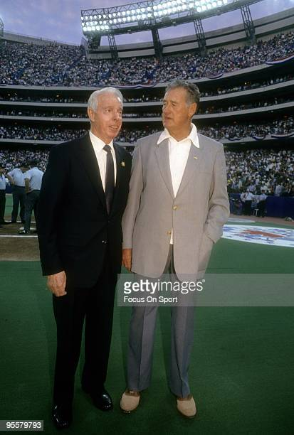 CIRCA 1990's Ex New York Yankee Great Outfielder Joe DiMaggio and ex Boston Red Sox Great Ted Williams on the field before a Major League Baseball...