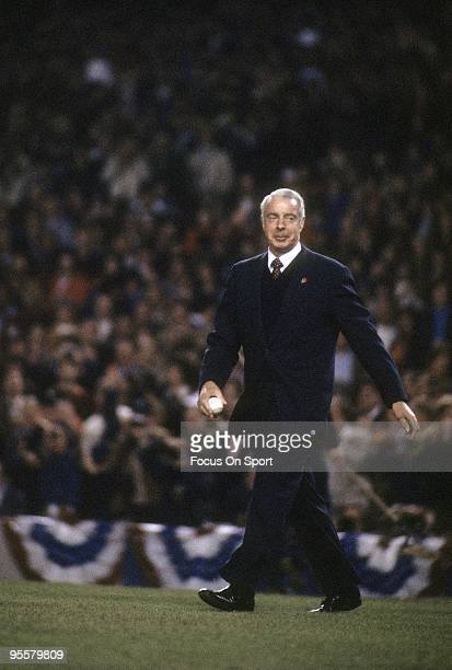 BRONX NY CIRCA 1980's Ex New York Yankee Great Outfielder Joe DiMaggio walks to the pitchers mound to throw out the traditional first pitch before a...
